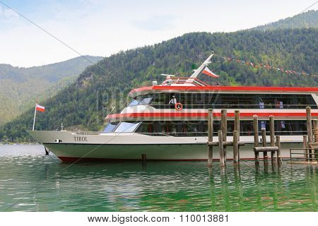 ACHENKIRCH, AUSTRIA - JULY 2015 : A ferry boat cruising along the Achensee Lake in Tirol, Austria, Central Europe on July 12, 2015. The Achensee is the largest lake within the federal state
