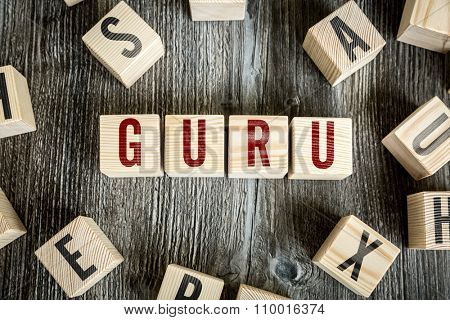 Wooden Blocks with the text: Guru