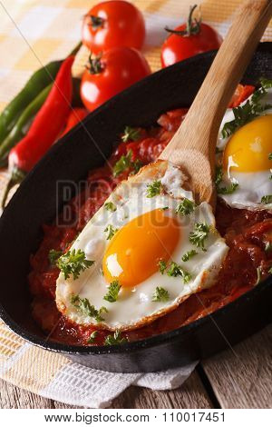 Huevos Rancheros: Fried Egg With Salsa Closeup In The Pan. Vertical