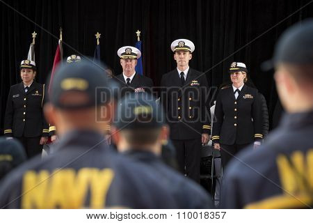 NEW YORK - NOV 25 2015: Naval officers on VIP stage before Rear Admiral Cynthia M. Thebaud, Commander Expeditionary Strike Group 2 swears recruits to the US Navy at Americas Parade on Veterans Day.