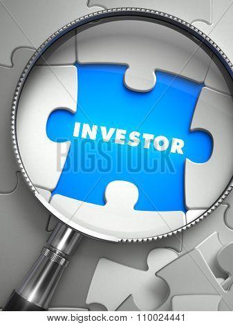 Investor - Missing Puzzle Piece through Magnifier.