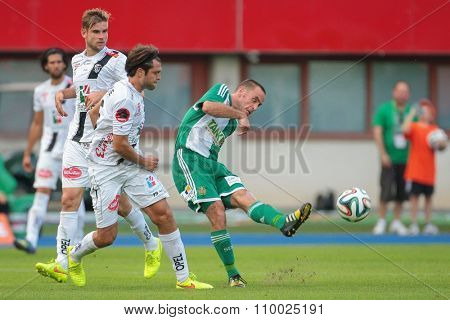 VIENNA, AUSTRIA - SEPTEMBER 20, 2014: Steffen Hofmann (#11 Rapid) kicks the ball in an Austrian soccer league game.