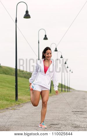 Sporty Fitness Woman Stretching Legs Before Running
