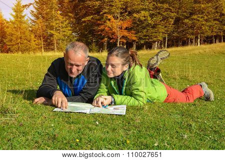Hikers Couple With Map