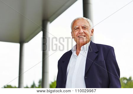 Happy old senior business man smiling outdoors