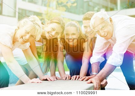 Happy smiling people with many hands helping together for teamwork