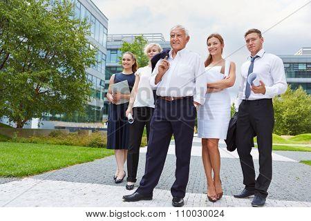 Senior business man taking leadership for team in summer