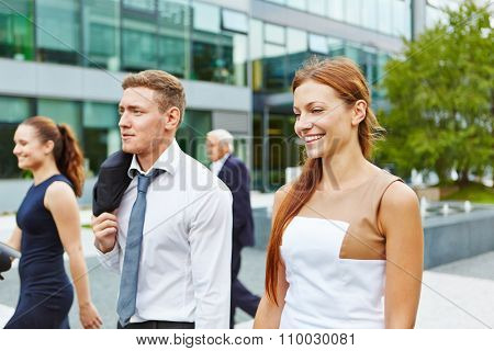Successful young business people walking together in the same direction