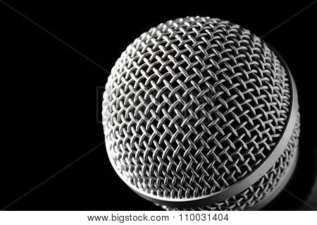 Silver Microphone On A Black Background.