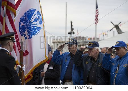 NEW YORK - NOV 25 2015: Vets who served on the USS Intrepid salute for the Presentation of Colors by the NYC Joint Service Color Guard at the Intrepid Museum ceremony at Pier 86 on Veterans Day.