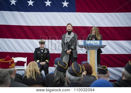 NEW YORK - NOV 25 2015: Susan Marenoff-Zausner, Pres. Intrepid Sea, Air, & Space Museum introduces Army vet Loree Sutton, Commissioner NYC Mayors Off. of Veterans Affairs at the event on Veterans Day.