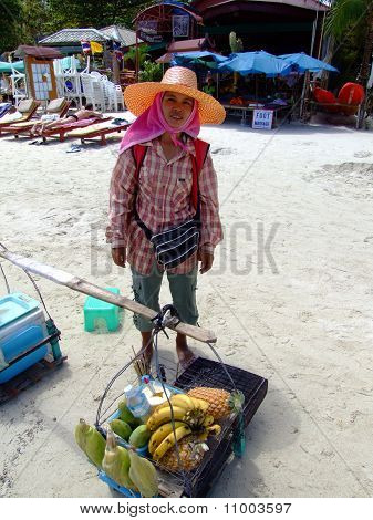 Thai woman selling fruit on the beach,