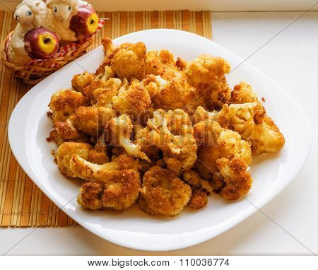 Roasted Cauliflower In Breadcrumbs On White Plate
