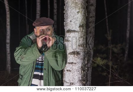 Senior man calling for help lost in a forest