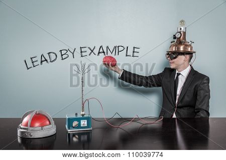 Lead by example concept with businessman holding brain