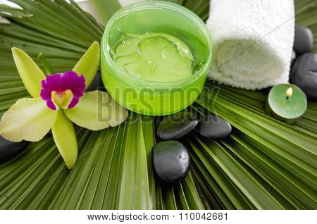 Spa set on green palm leaf