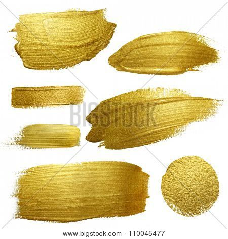Gold paint smear stroke stain set. Abstract gold glittering textured art illustration. Abstract gold glittering textured art illustration.
