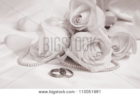 Wedding Rings And Roses As Wedding Background. In Sepia Toned. Retro Style