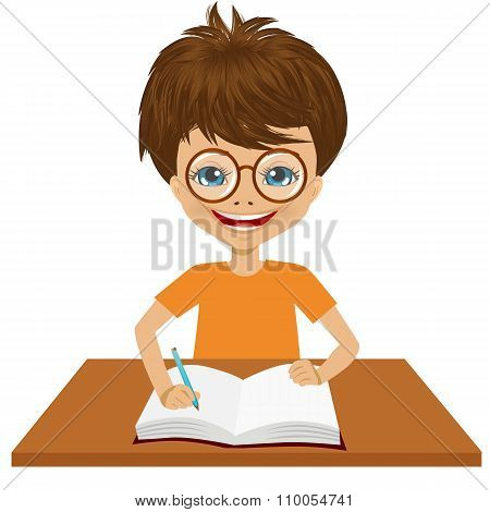 cute little caucasian student boy writing