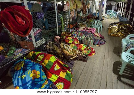 BAGAN, MYANMAR, JANUARY 22, 2015 : The Burmese passengers are sleeping in the night on the boat's deck going from Mandalay to Bagan in Myanmar (Burma).