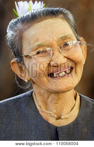 BAGAN, MYANMAR, JANUARY 24, 2015 : Portrait of a  senior Burmese woman having Periodontitis in the village of old Bagan, Myanmar (Burma).