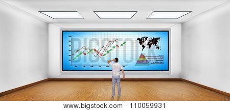 Man Looking At Plasma Tv With Chart