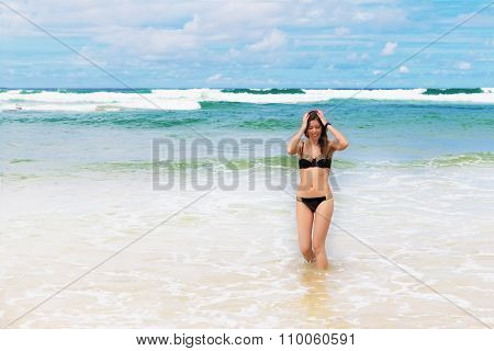 Young Pretty Woman Have Sun Bath On The Cost Of Ocean