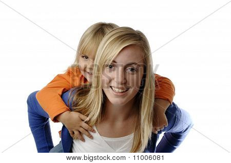 Teenage Girl Piggybacks A Todler