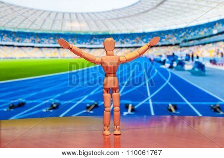 Wooden dummy, mannequin or man figurine, silhouette Of athlete standing with champion arms raised in