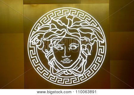 SINGAPORE - NOVEMBER 08, 2015: close us shot of Versace logo on the wall. Versace, is an Italian fashion company and trade name founded by Gianni Versace in 1978