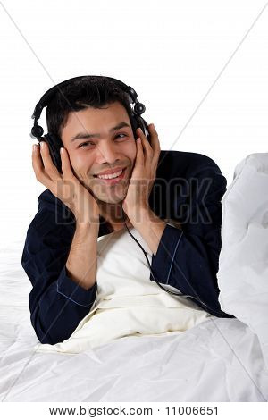 Nepalese Man In Pajamas, Headphones