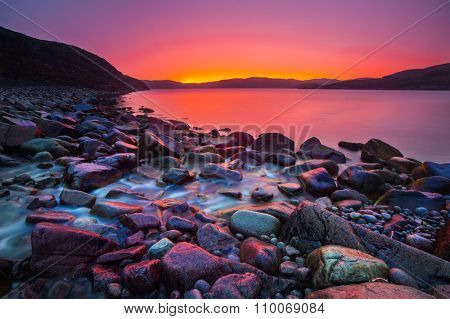 Sunset on the stone coast and river