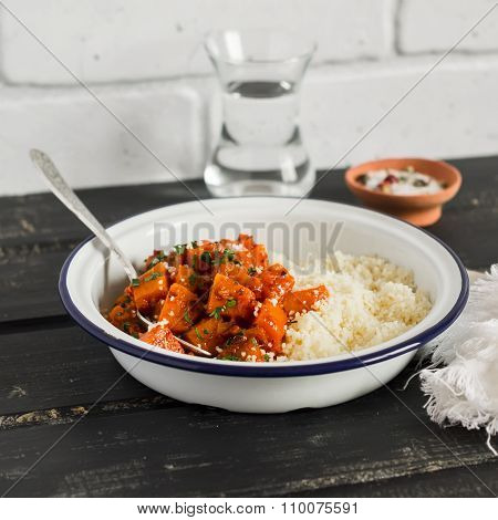 Healthy Food - Pumpkin Stew And Couscous In A White Enamel Bowl On A Dark Wooden Board. A Vegetarian