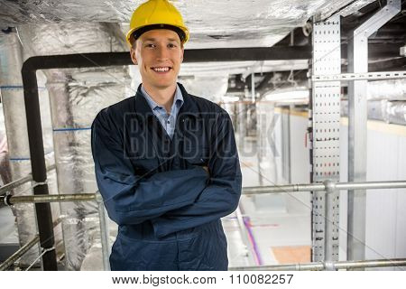 Engineer smiling at the camera in temperature control room