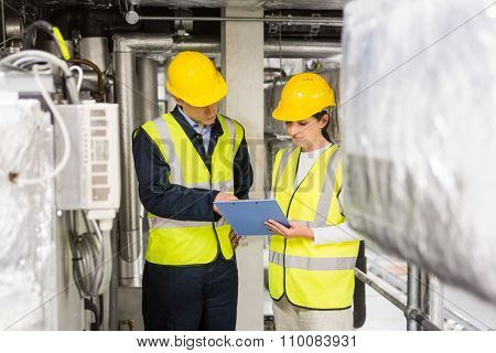 Engineers working in temperature control room of large building