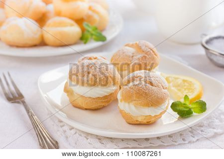 Profiteroles With Cream And Powdered Sugar