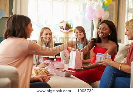 Group Of Female Friends Meeting For Baby Shower At Home