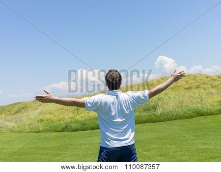 Happy summer vacation for man on green meadow near sea