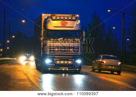 Nighttime Daf XF Flower Truck And City Lights