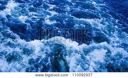 Blue Water Bubbling And Foaming