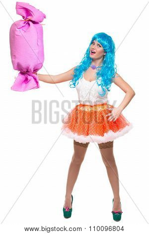 sexy girl doll with blue hair. huge candy in the hands. confectionery.
