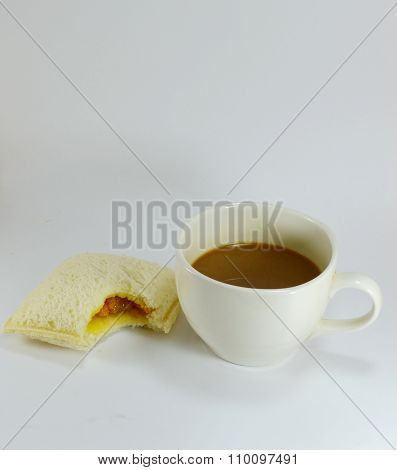 bite  out of sandwich and coffee