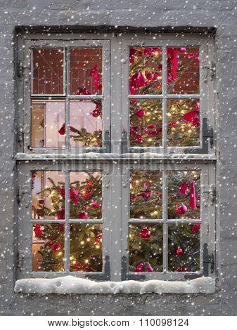 window, snowfall and christmas tree