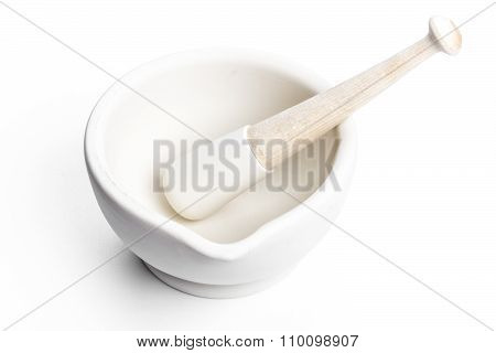 Mortar And Pestle On A Plane Background
