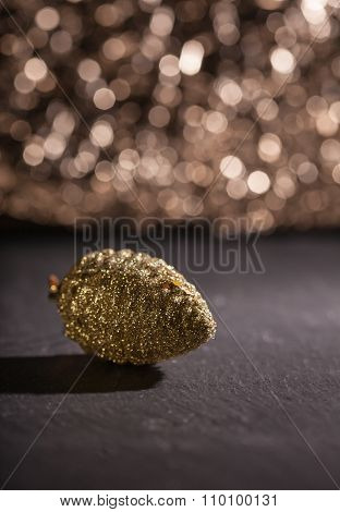 Golden Pine Cone Ornament, Bokeh Background