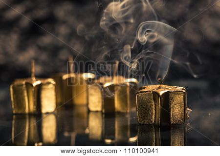 Smoking Golden Candle