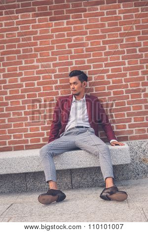Handsome Asian Model Sitting In The City Streets