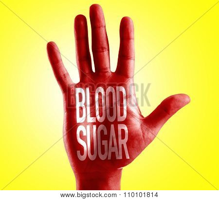 Blood Sugar written on hand with yellow background