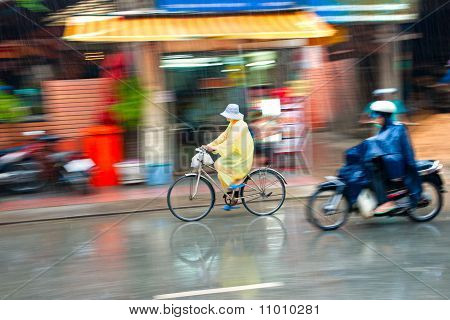 Motion Blur Astract Of A Bike And A Motorbike Rider In Ho Chi Minh City, Vietnam.