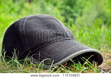 Gray Baseball Cap Lying On Green Grass